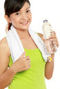 Fitness woman drinking water Stock Images