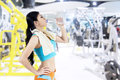 Fitness woman drinking water asian from a bottle shot at center Stock Images