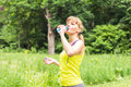 Fitness woman drinking water after work out exercising on summer outdoor portrait Royalty Free Stock Photo