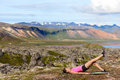 Fitness woman exercising single leg glute bridge exercise training butt and legs outside in beautiful nature landscape on iceland Royalty Free Stock Image