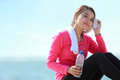 Fitness woman have a break portrait of asian healthy holding bottle of water while having Royalty Free Stock Image