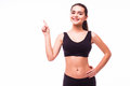 Fitness woman hold hand showing something on the open palm Royalty Free Stock Photo