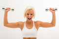 Fitness woman lift dumbbells  white Stock Images