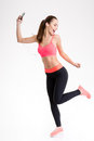 Fitness woman listening to music from mobile phone and dancing Royalty Free Stock Photo