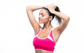 Fitness woman making ponytail isolated on a white background Stock Photo