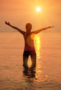 Fitness woman open arms to sunrise sunset Royalty Free Stock Photo