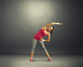 Fitness woman over dark background full length photo of Stock Photo
