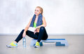 Fitness woman resting after exercises in gym Royalty Free Stock Photo