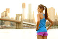 Fitness woman runner relaxing after city running and working out outdoors in new york usa girl looking and enjoying view of Royalty Free Stock Photos