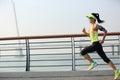 Fitness woman runner running at seaside Royalty Free Stock Photo