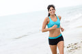 Fitness woman running on beach Royalty Free Stock Photo