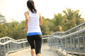 Fitness woman running at city footbridge healthy lifestyle young asian modern Stock Photo