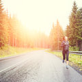 Fitness woman running at the morning in mountains. Royalty Free Stock Photo
