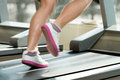 Fitness woman running on treadmill close up of female legs blurred motion Stock Photo