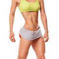 Fitness woman showing abs and flat belly. Sexy muscular woman Royalty Free Stock Photo
