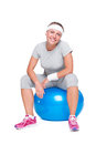 Fitness woman sitting on ball Stock Image