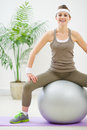Fitness woman sitting on fitness ball Royalty Free Stock Image
