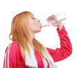 Fitness woman sport girl with towel drinking water from bottle isolated Royalty Free Stock Photo