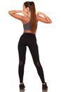 Fitness woman in sport style standing against isolated white background Royalty Free Stock Photo