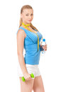 Fitness woman with water, dumbbells and tape measure