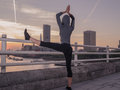 Fitness woman in yoga pose on bridge at sunrise Royalty Free Stock Photo