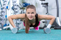 Fitness woman young beautiful girl doing sport exercises in the gym Stock Photo