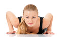 Fitness woman young doing push up isolated on white background Stock Photography
