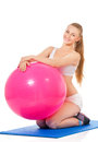Fitness woman young happy doing exercise with ball isolated on white background Stock Photos
