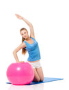 Fitness woman young happy doing exercise with ball isolated on white background Stock Photography