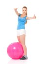 Fitness woman young happy doing exercise with ball isolated on white background Royalty Free Stock Image