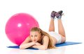 Fitness woman young happy doing exercise with ball isolated on white background Royalty Free Stock Images