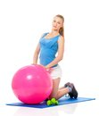 Fitness woman young happy doing exercise with ball isolated on white background Royalty Free Stock Photo