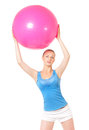 Fitness woman young happy doing exercise with ball isolated on white background Stock Image
