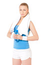 Fitness woman young with towel and bottle of water isolated on white background Royalty Free Stock Images