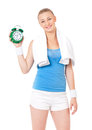 Fitness woman young with towel and green alarm clock isolated on white background Stock Photography