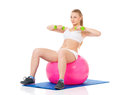 Fitness woman young in wear exercising with ball and dumbbells isolated on white background Stock Image