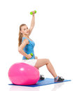 Fitness woman young in wear exercising with ball and dumbbells isolated on white background Stock Photo