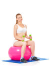 Fitness woman young in wear exercising with ball and dumbbells isolated on white background Royalty Free Stock Image