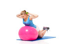 Fitness woman young in wear exercising with ball and dumbbells isolated on white background Royalty Free Stock Photography