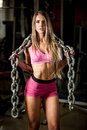 Fitness workout popular beautiful young woman workout in gym training body building for bikini category Royalty Free Stock Image