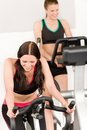 Fitness young girl on gym bike Royalty Free Stock Photos