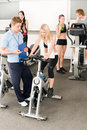 Fitness young girls at gym with instructor Royalty Free Stock Photography
