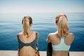 Fitness young girls relaxing after running in city. Royalty Free Stock Photo