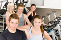 Fitness young group people at gym bicycle Stock Images