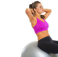 Fitness young woman doing abdominal crunch on fitness ball isolated white Stock Image