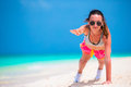Fitness young woman doing push ups exercise on beach
