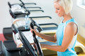 Fitness young woman on elliptical cross trainer Royalty Free Stock Photography