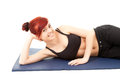 Fitness young woman lying on the floor Royalty Free Stock Photography