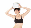 Fitness young woman with stack of books on head Stock Photography