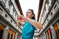 Fitness young woman stretching next to Uffizi gallery, Florence Royalty Free Stock Photo